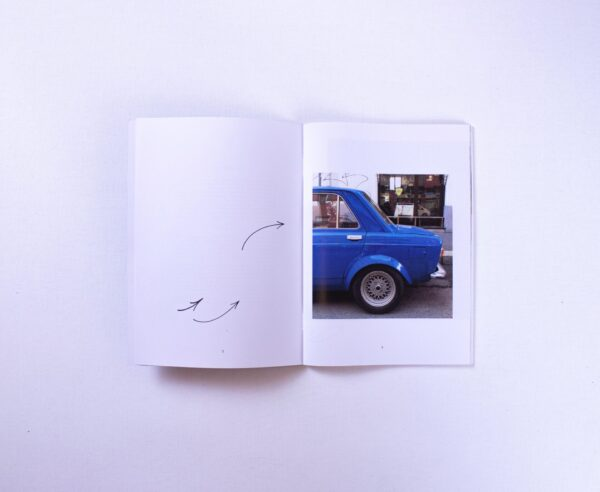 A magazine opened on a car photo page